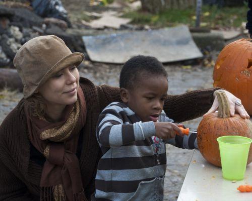 Young Boy Carving A Jack-O-Lantern